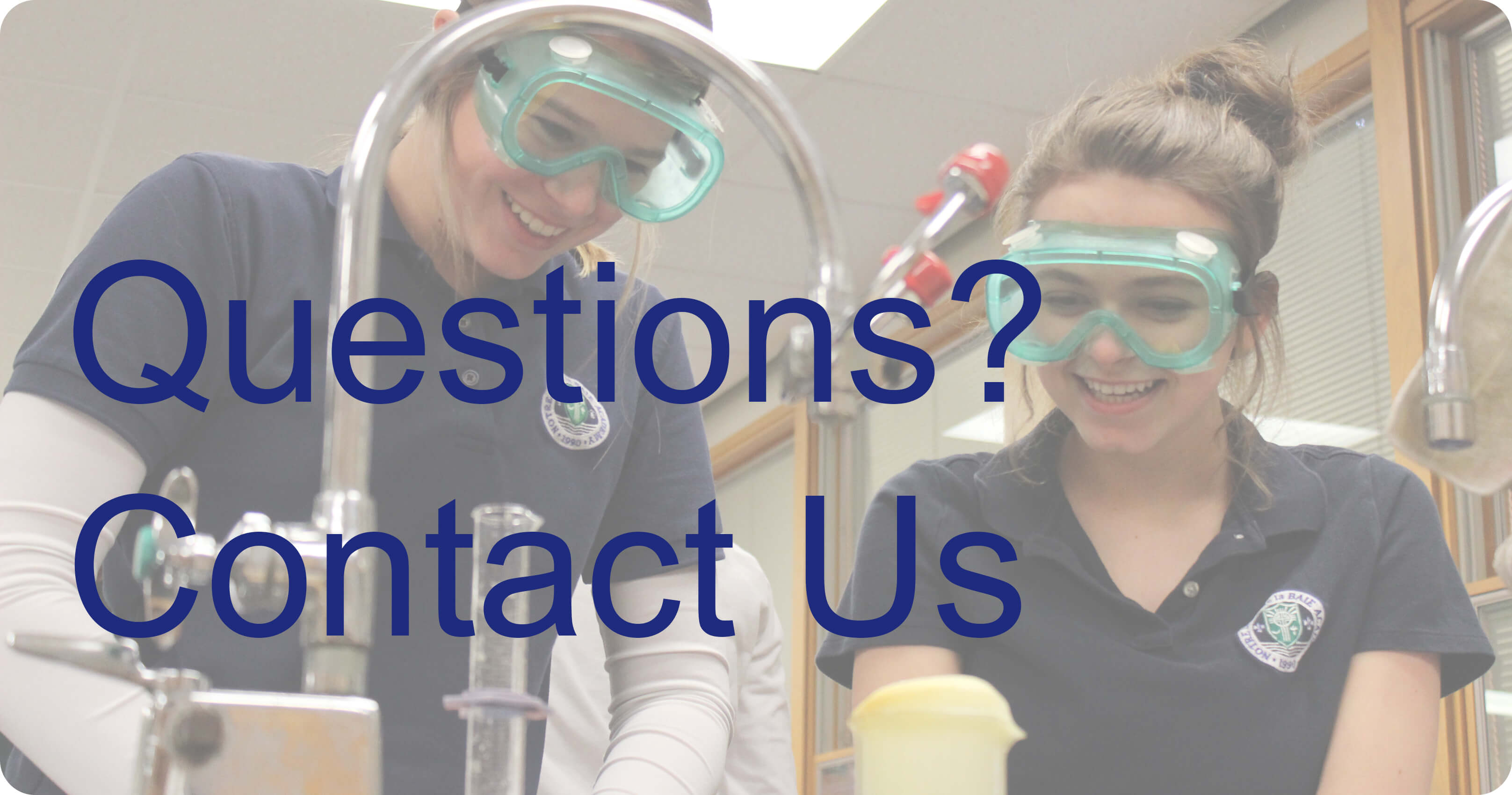 Photo of two students in a science lab with text over it saying Questions? Contact Us