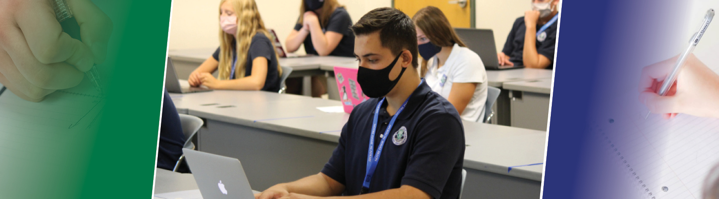 Photo of students working on laptops in classroom while wearing masks.